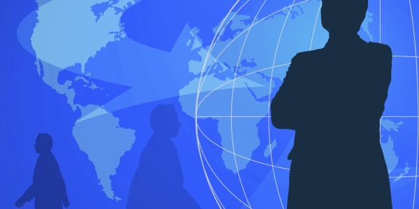 Businessman silhouettes. Blue world map on background.